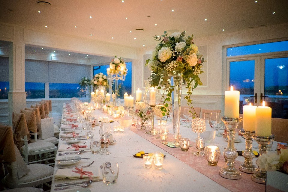 "Kate's favorite piece of decor -""I love long tables with lots of candles and subtle styling, it creates a beautiful atmosphere."""
