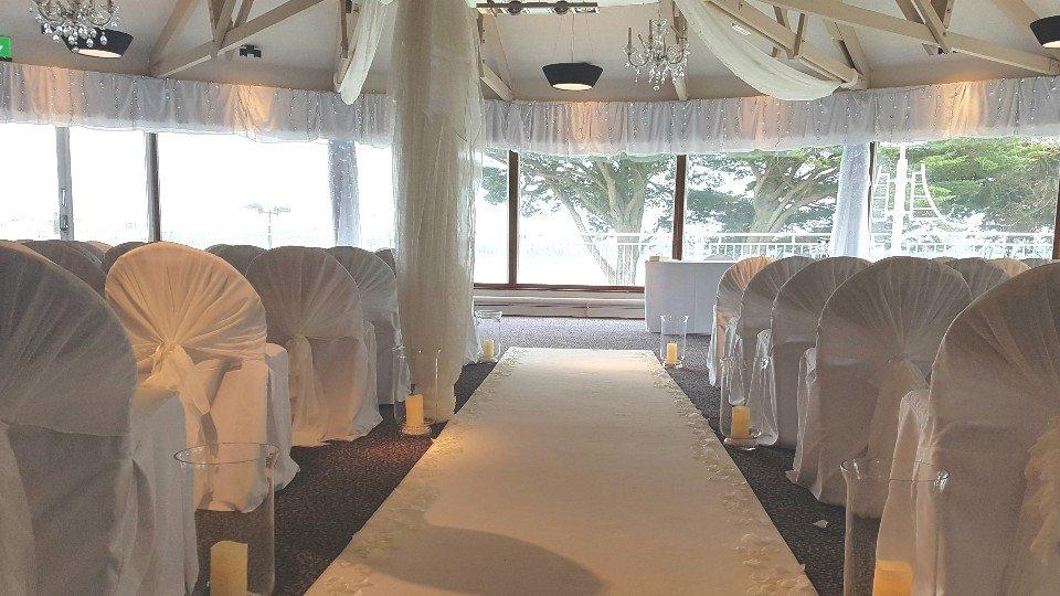 Stunning carpet of petals on our elegant white aisle carpet and accessorised with lanterns.