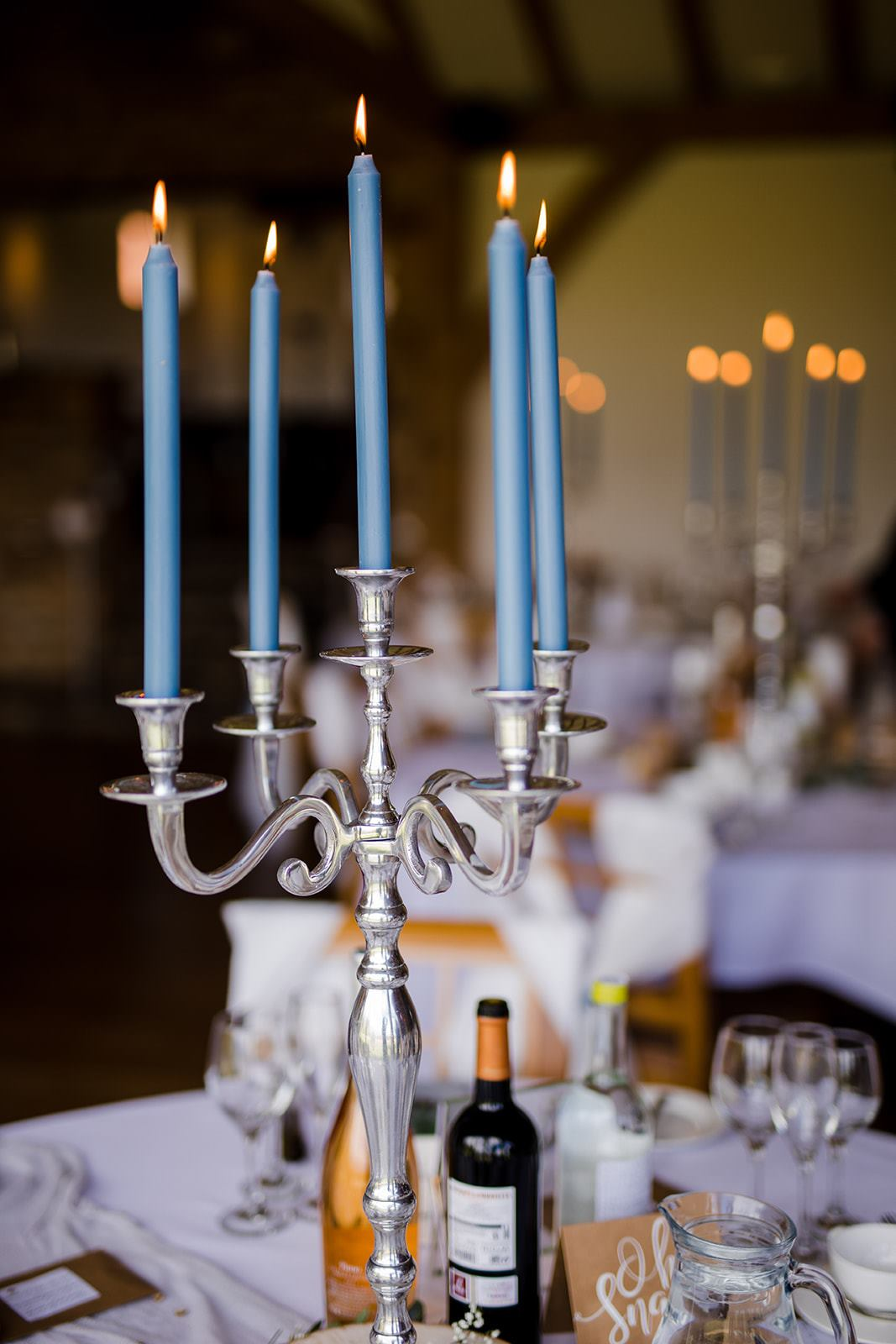 Candelabra centrepiece. We offer a wide range of centrepieces that include candles or light effects.