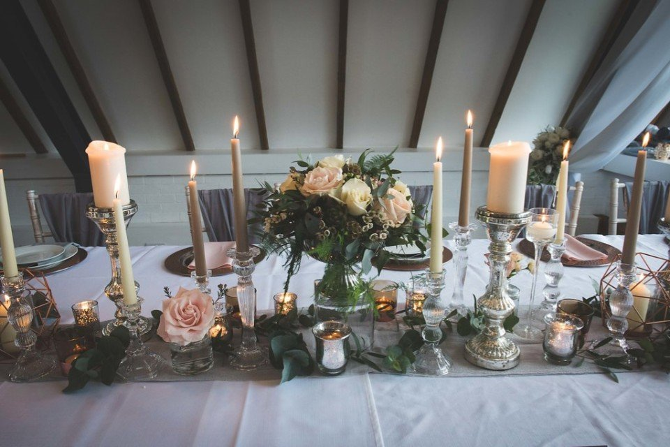 Give your top table the wow factor with our floral table runners or lots of floating candles along the foot of the table.