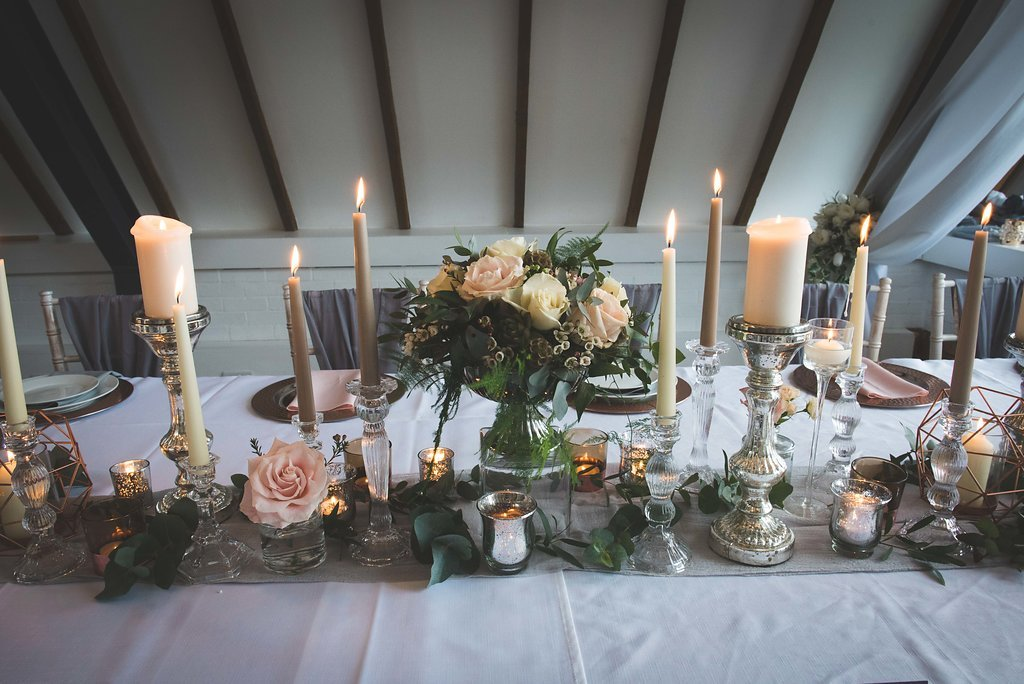 Table feature. Candle light centrepiece, table dressing and chair covers.