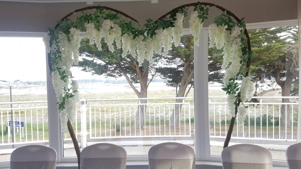 Making a huge impact with beautiful arched trees. Stylish, wedding venue ideas.