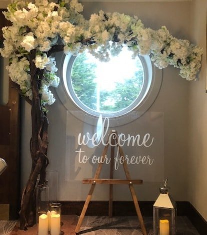 Wedding hire collection - Welcome to our forever sign. Blossom arch tree and floating candles.